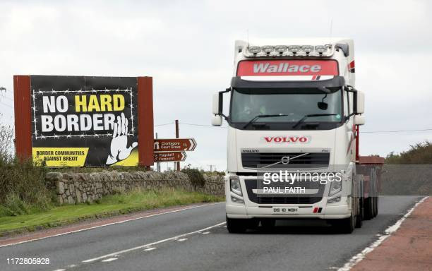 A lorry passes a billboard with an antiBrexit no hard border slogan seen from the Dublin road in Newry Northern Ireland on October 1 2019 on the...