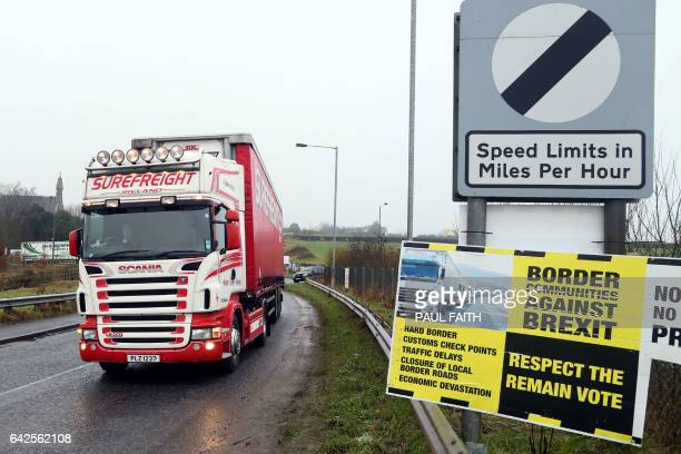 A lorry passes a placard at the border crossing in Killeen near Dundalk protesting against the potential introduction of border checks following the...
