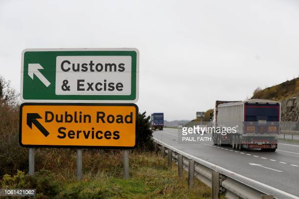 A lorry passes a sign on a main road outside Newry Northern Ireland on November 14 2018 pointing towards an old customs and excise station near the...