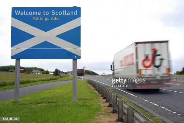 Lorry passes a welcome sign as it crosses the border into Scotland near Berwick-upon-Tweed in northern England close to the border between England...