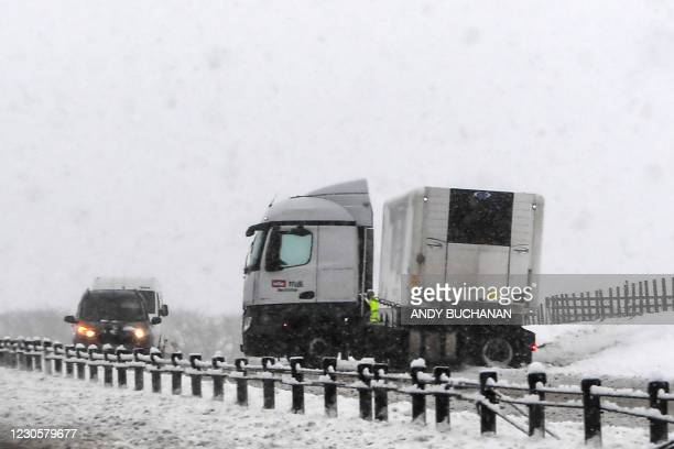 Lorry sits jackknifed on the southbound A9 road near Gleneagles as heavy snow fell on parts of Scotland on January 14, 2021.