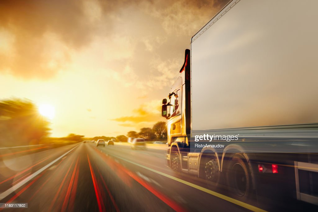 Lorry Traffic Transport on motorway in motion : Stock Photo