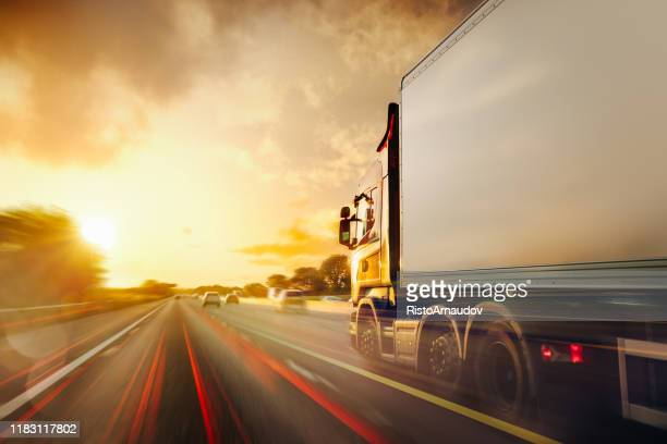 lorry traffic transport on motorway in motion - transportation stock pictures, royalty-free photos & images
