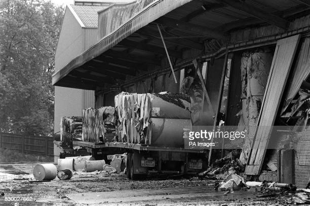 A lorryload of newsprint paper rolls lies in ruins at the smouldering warehouse owned by Rupert Murdoch's News International in Deptford London after...