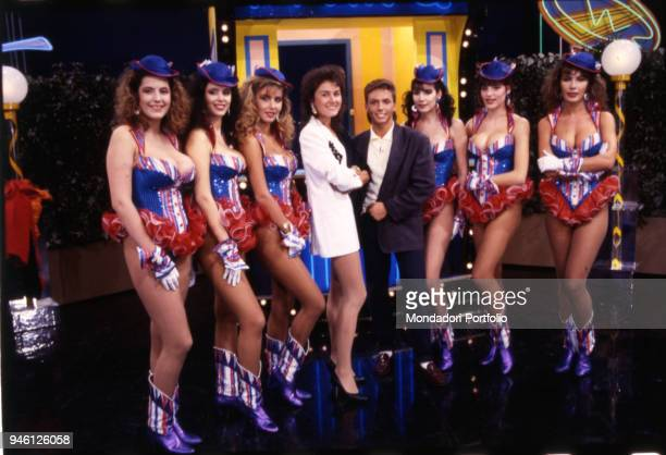 Lory Del Santo and Piersilvio Berlusconi posing among the fast food girls of the famous TV comic show 'Drive In' broadcasted by Italia 1. Milan , 1986