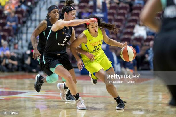 Loryn Goodwin of the Dallas Wings defended by Kia Nurse of the New York Liberty during the Dallas Wings Vs New York Liberty WNBA pre season game at...