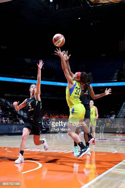 Loryn Goodwin of the Dallas Wings shoots the ball against the New York Liberty during a preseason game on May 7 2018 at Mohegan Sun Arena in...