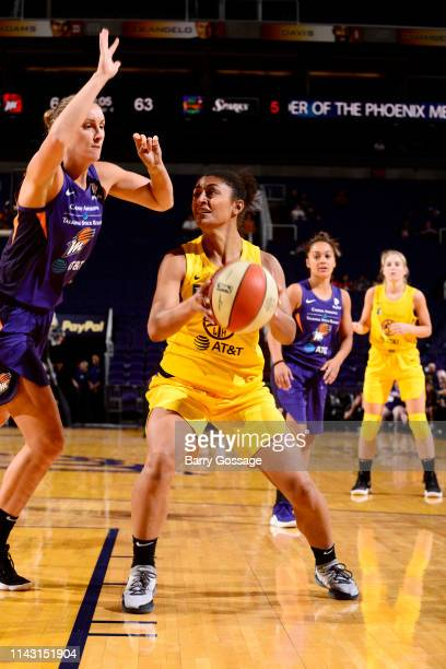 Loryn Goodwin of the Los Angeles Sparks handles the ball against the Phoenix Mercury during a preseason game on May 11 2019 at the Talking Stick...