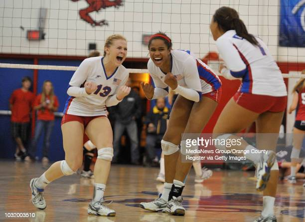 ALAMITOS CALIF USA Los Alamitos' Jordyn Schnabl and Jones Crissy celebrate a point during their loss to Marymount during the SoCal Regional Division...