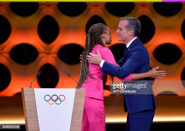 Los Angeles 2028 bid delegation members Los Angeles Mayor Eric Garcetti and Olympian Allyson Felix greet each other as they deliver their speeches...