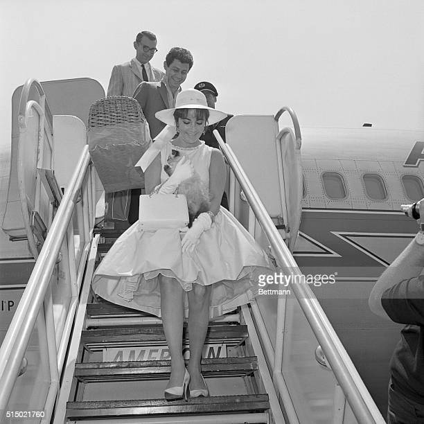 Actress Elizabeth Taylor and singer husband Eddie Fisher returned home 7/18 from a visit to the Moscow Film Festival with a new pet AliKahn a...