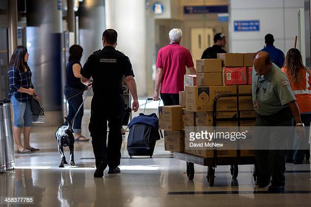Los Angeles Airport Police officer watches over travelers at Los Angeles International Airport on July 2 2016 in Los Angeles California Security is...