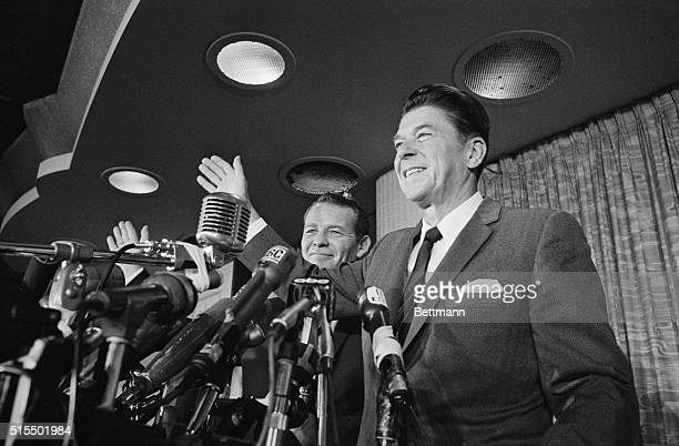 Los Angeles: Amid a sea of microphones and fresh from his landslide victory in California, Gov.-elect Ronald Reagan accompanied by Lt. Gov.-elect...