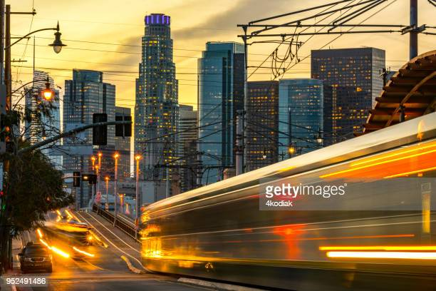 los angeles and traffic at dusk - railing stock pictures, royalty-free photos & images
