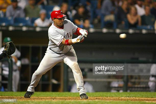 Los Angeles Angels' Catcher Bengie Molina lays down a sacrifice bunt during the game against the Chicago White Sox September 9 2005 at US Cellular...