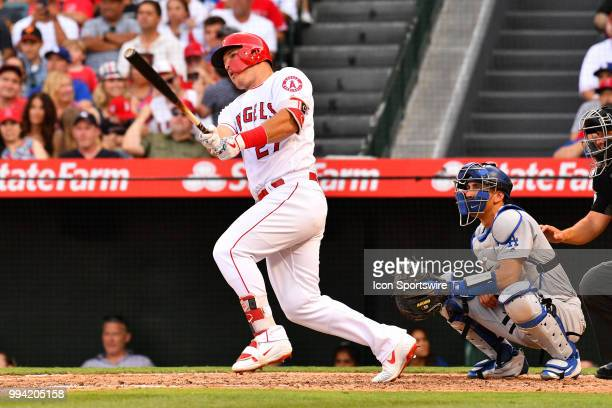 Los Angeles Angels center fielder Mike Trout hits a base hit during a MLB game between the Los Angeles Dodgers and the Los Angeles Angels of Anaheim...
