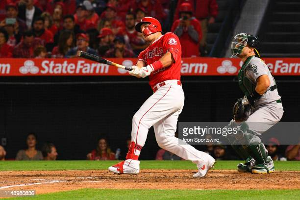 Los Angeles Angels center fielder Mike Trout hits a home run during a MLB game between the Athletics and the Los Angeles Angels of Anaheim on June 6,...