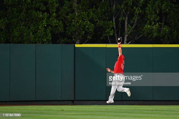 Los Angeles Angels center fielder Mike Trout jumps to rob Chicago White Sox left fielder Eloy Jimenez of a hit during a MLB game between the Chicago...