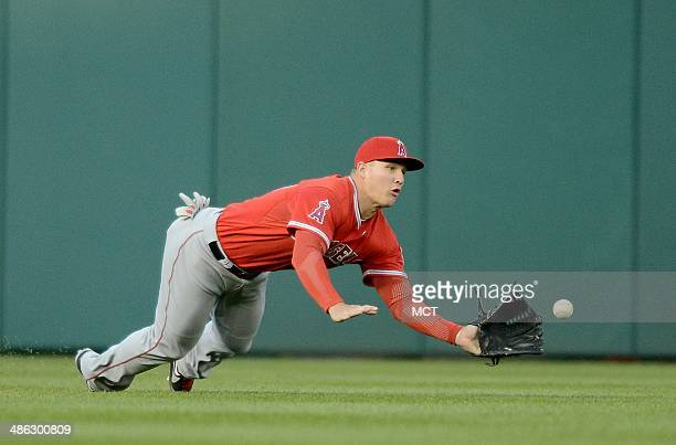 Los Angeles Angels center fielder Mike Trout makes a diving catch on a line drive hit by Washington Nationals left fielder Bryce Harper to end the...