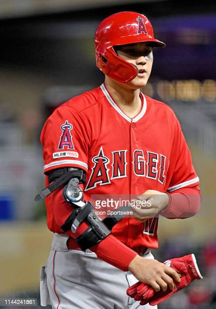 Los Angeles Angels Designated hitter Shohei Ohtani adjusts his elbow brace during a game between the Los Angeles Angels and Minnesota Twins on May 13...