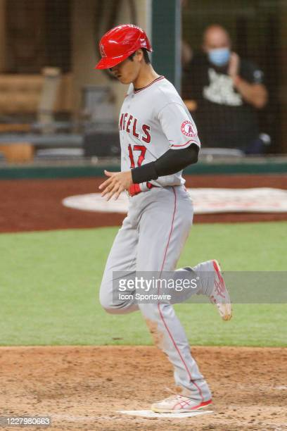 Los Angeles Angels designated hitter Shohei Ohtani crosses home plate during the MLB game between the Los Angeles Angels and Texas Rangers on August...