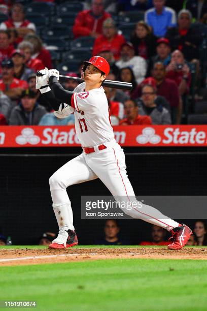 Los Angeles Angels designated hitter Shohei Ohtani hits a sacrifice fly during a MLB game between the Cincinnati Reds and the Los Angeles Angels of...