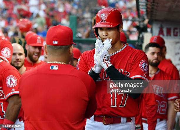 Los Angeles Angels designated hitter Shohei Ohtani in the dugout after hitting a solo home run in the first inning of a game against the Los Angeles...