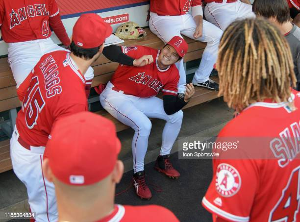 Los Angeles Angels designated hitter Shohei Ohtani in the dugout with teammates all wearing Tyler Skaggs before the start of a game against the...