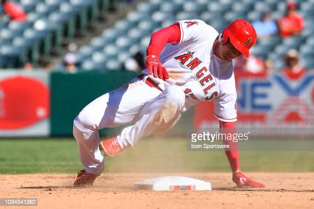 Los Angeles Angels Designated hitter Shohei Ohtani is shaken up after trying to steal second base during a MLB game between the Seattle Mariners and...