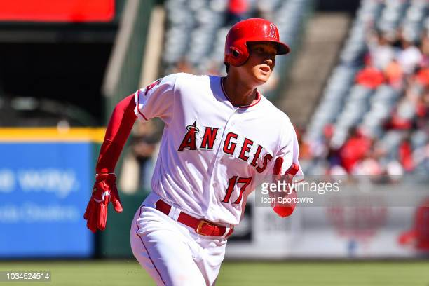 Los Angeles Angels designated hitter Shohei Ohtani runs towards third base during a MLB game between the Seattle Mariners and the Los Angeles Angels...