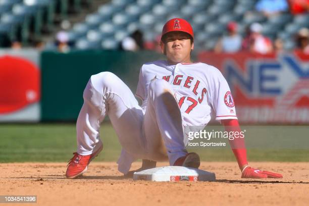 Los Angeles Angels Designated hitter Shohei Ohtani sits on second base after being thrown out at second trying to steal during a MLB game between the...