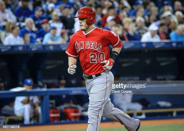 TORONTO ON MAY 12 Los Angeles Angels first baseman CJ Cron heads for the dugout after scoring during the game between the Toronto Blue Jays and the...