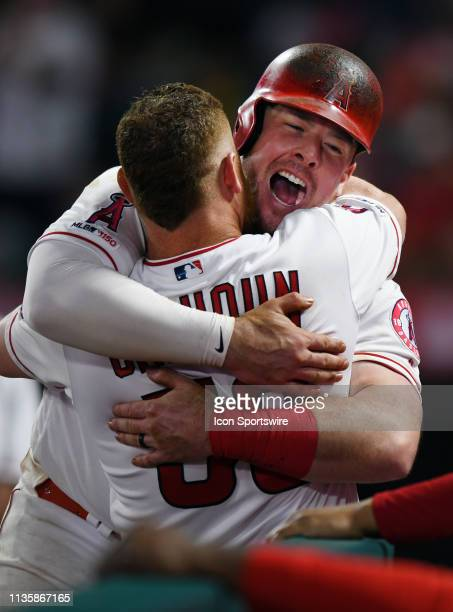 Los Angeles Angels first baseman Justin Bour hugs right fielder Kole Calhoun after Bour hit a two run home run in the eighth inning of a game against...