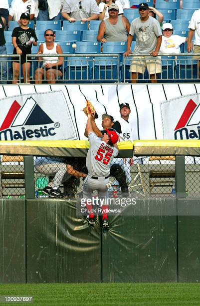 Los Angeles Angels' Left Fielder Jeff DaVanon leaps but can't catch Juan Uribe's 9th inning home run during the game against the Chicago White Sox...