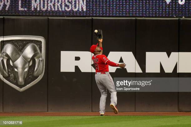 Los Angeles Angels left fielder Justin Upton makes a catch on the track to retire Cleveland Indians shortstop Francisco Lindor during the seventh...