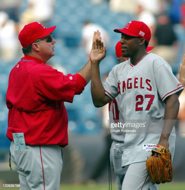 Los Angeles Angels' Manager Mike Scioscia and Vladimir Guerrero celebrate their three game sweep over the White Sox September 11 2005 at US Cellular...