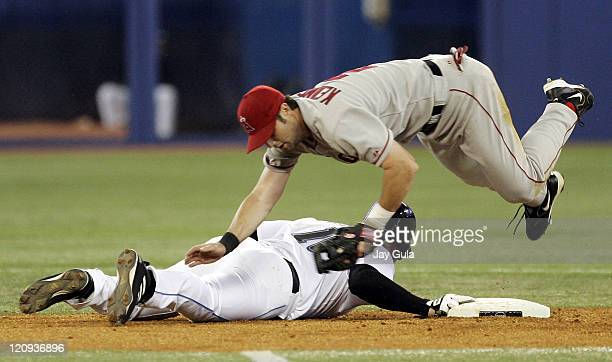 Los Angeles Angels of Anaheim 2nd baseman Adam Kennedy dives over Toronto's Eric Hinske after an attempted pick off in MLB action vs the Toronto Blue...