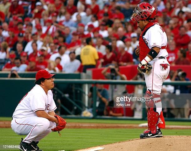 Los Angeles Angels of Anaheim catcher Bengie Molina talks with starting pitcher Bartolo Colon during 42 loss to the New York Yankees in MLB Division...