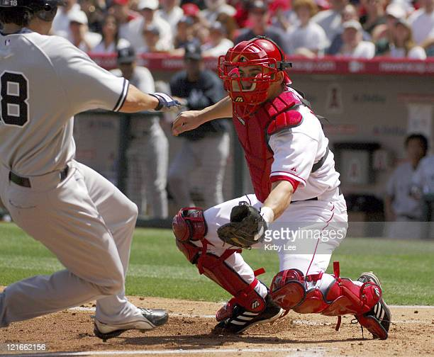 Los Angeles Angels of Anaheim catcher Jeff Mathis tags out Johnny Damon of the New York Yankees in the second inning at Angel Stadium in Anaheim...