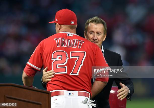 Los Angeles Angels of Anaheim Center field Mike Trout hugs Angeles team owner Arte Moreno during Trout's ceremony to receive his 2016 MVP and Silver...
