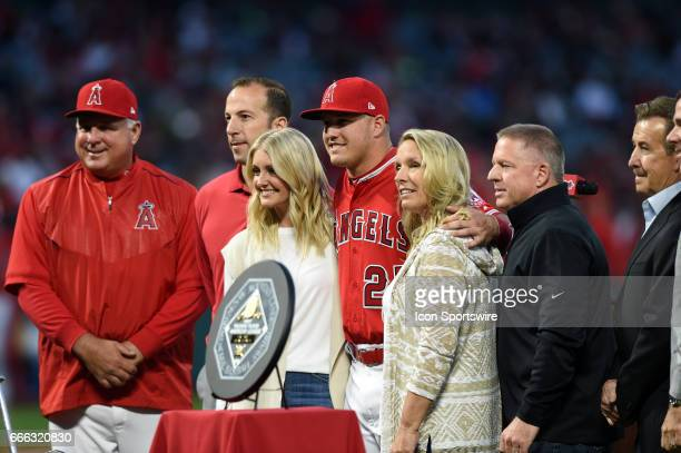 Los Angeles Angels of Anaheim Center field Mike Trout poses with his parents fiancé Los Angeles Angels of Anaheim Manager Mike Scioscia and members...