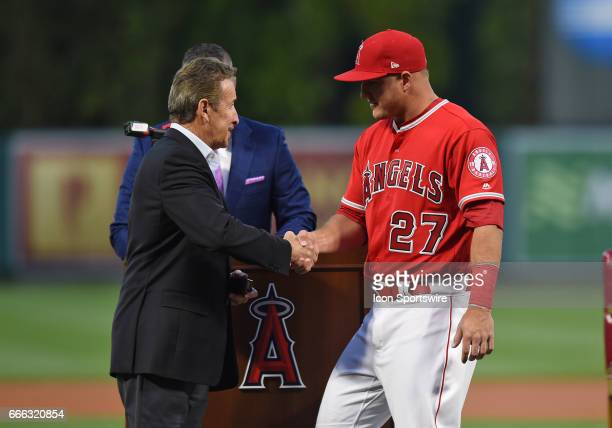 Los Angeles Angels of Anaheim Center field Mike Trout shakes the hand of Angels team owner Arte Moreno during Trout's ceremony to receive his 2016...