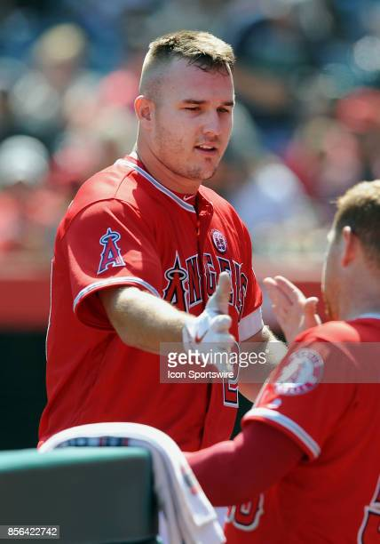 Los Angeles Angels of Anaheim center fielder Mike Trout is greeted by left fielder Kole Calhoun after Trout was pulled from the game in the fourth...