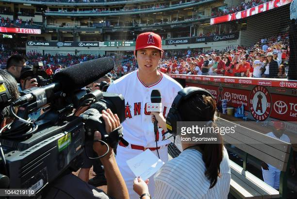 Los Angeles Angels of Anaheim designated hitter Shohei Ohtani does an interview with NHK TV after the Angels defeated the Oakland Athletics 5 to 4 in...