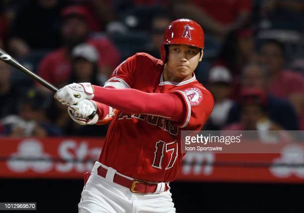 Los Angeles Angels of Anaheim designated hitter Shohei Ohtani hits a single in the second inning of a game against the Detroit Tigers played on...