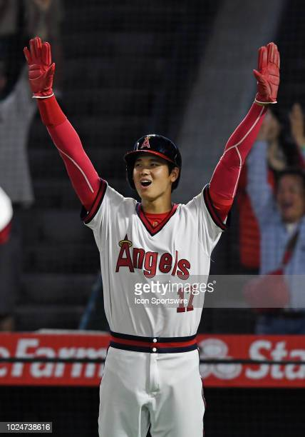 Los Angeles Angels of Anaheim designated hitter Shohei Ohtani reacts after Ohtani scored on an Angels hit in the eighth inning of a game against the...