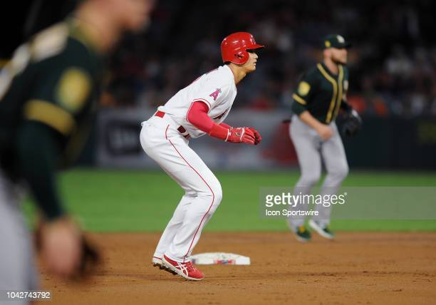 Los Angeles Angels of Anaheim designated hitter Shohei Ohtani takes a lead off second base during the second inning of a game against the Oakland...