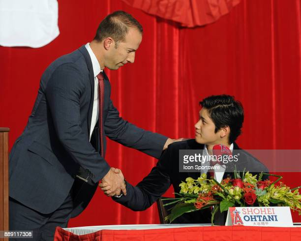 Los Angeles Angels of Anaheim general manager Billy Eppler shakes the hand of pitcher from Japan Shohei Ohtani during an outdoor press conference...