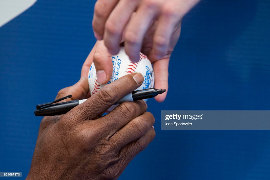 Los Angeles Angels of Anaheim infield coach Alfredo Griffin (4) hands a ball he just autographed to a fan before the regular season MLB game between the Los Angeles Angels of Anaheim and the Toronto Blue Jays at Rogers Centre in Toronto, ON., Canada July 29, 2017.