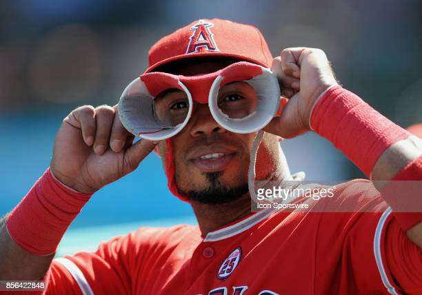Los Angeles Angels of Anaheim infielder Luis Valbuena looks through home made cup binoculars during a game against the Seattle Mariners on October 1...